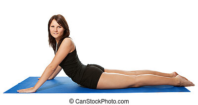 Young women doing core stretch on fitness mat