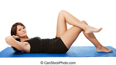 Young women doing crunches on the fitness mat