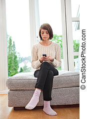 Young woman text messaging - Young attractive woman text...