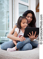 Mother and Daugther with Digital Tablet - Happy mother and...