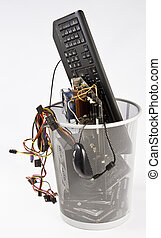 electronic waste in wast basket