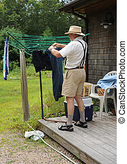 Wash day. - Country gentleman washing and hanging his...