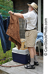 Wash day - Country gentleman washing and hanging his clothes...