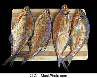 Smoked fish - Four smoked breams on a bamboo board on a...