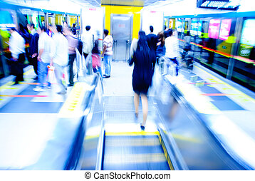 passenger on moving escalator in Guangzhou subway station