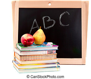 blackboard and textbooks with fruit