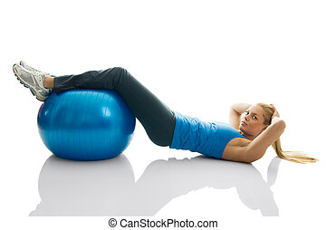 Young women doing crunches on fitness ball Isolated on white...