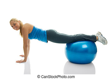 Young women doing pushups on fitness ball Isolated on white