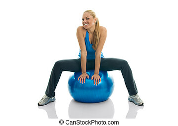 Young women posing on fitness ball Isolated on white