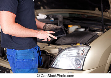Mechanic with Digital Tablet - Detail of a mechanic with a...