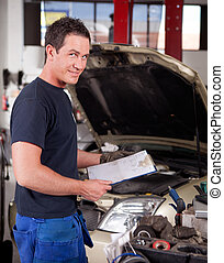 Mechanic with Service Report - Portrait of a mechanic,...