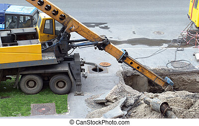 Excavate - Replacement of old water pipes. Excavator dug a...