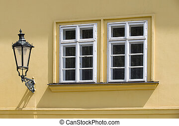 Historic house with two windows and a street light