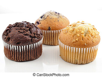 muffins - chocolate , banana and blueberry muffins on white...
