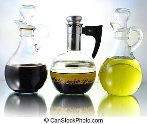 oil , vinegar and salad dressing bottles
