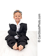 Little girl in large business clothes