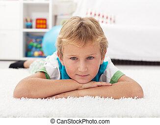 Beautiful kid resting on the floor