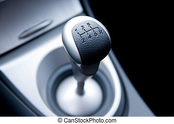 Six speed gear stick in a brand new sport car shallow DoF