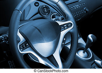 Car interior toned in blue