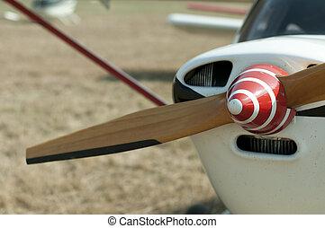 Wooden plane propeller. White plane