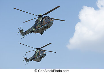 Green military helicopters. Horizontal image - Two green...