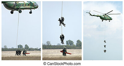 Military operation with helicopters. Rescue soldier. Tree...