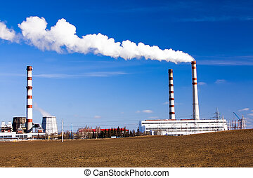 The industry - Smoke going from the pipes located at factory...