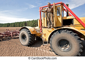 Farmer with truck - Farmer on the field showing OK hand...