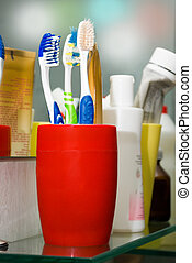 Colorful toothbrushes in a glass - Three colorful...
