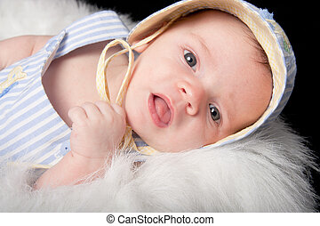Curious baby boy in hat with mouth open