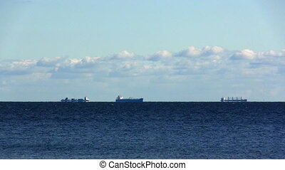 cargo ships waiting for the pilot