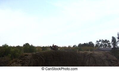 Moto Jump - This is a dirt bike jumping over a dirt jump...