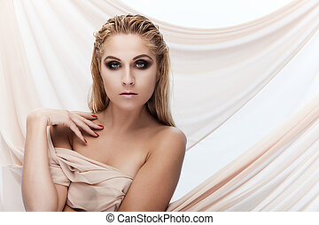 Pure beauty - Portrait of a young beautiful lady with beige...