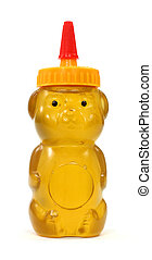 Honey in plastic bear container - Honey in a molded plastic...