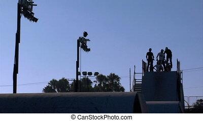 BMX Jumps Slow Motion - Slow motion silhouette shot of BMX...