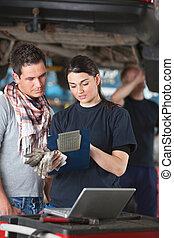 Female Mechanic Explaining Repairs to Client