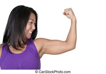 Asian Woman Flexing Her Muscles - A beautiful young Asian...
