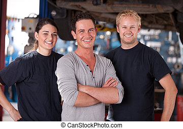 Mechanic Team - Portrait of a group of mechanics standing in...