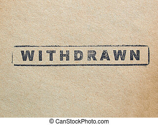 Withdrawn stamp on a book page
