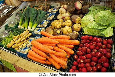 Vegetable Bin in Grocery Store - A vegetable bin full of...