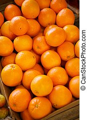 Navel Oranges in a crate - Some navel oranges being...