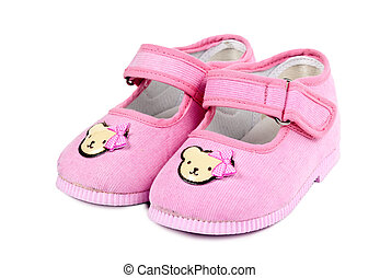 a pair of baby pink shoes