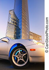 Modern sport car in front of office building