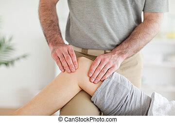 Male, Chiropractor, massaging, charming, woman's, knee