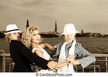 Threesome tango near the river