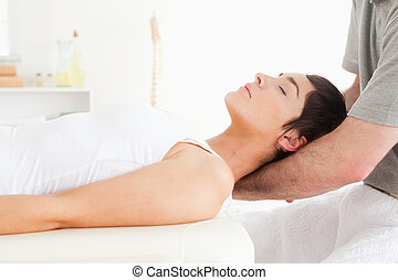 Woman relaxing during a massage in a room