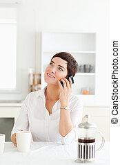 Woman with coffee on her mobile phone
