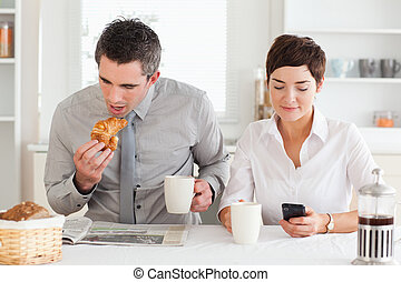 Couple having breakfast before work - A couple is having...