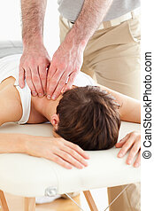 Woman getting a neck-massage in a room