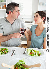 Close up of a Happy couple toasting with redwine in a dining...